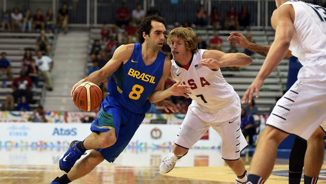 Brazil's Vitor Benite drives to the basket against USA's Ronald Baker during the preliminary round at the 2015 Pan American Games in Toronto on Thursday.