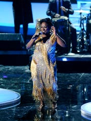 "FILE - In this Dec. 18, 2011 file photo, Sharon Jones & the Dap-Kings perform onstage at the ""Vh1 Divas Celebrates Soul,"" in New York. Jones, a big-voiced soul singer who performed with high energy onstage has died at age 60 in New York, after battling pancreatic cancer. Her representative Judy Miller Silverman says she died Friday, Nov. 18, 2016, at a Cooperstown hospital surrounded by her band, the Dap-Kings. (AP Photo/Evan Agostini, File)"