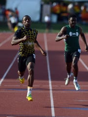 Desmond Melson runs in the 400 meter dash during the Division I semifinals Friday at Jesse Owens Stadium in Columbus.