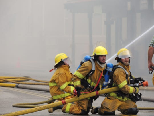 Volunteer firefighters battle a blaze in Portola, Calif. First responders started at 10 a.m. Friday and expected to go through the weekend.