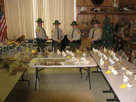 Pennsylvania Wildlife Conservation Officers show skulls and other animal parts confiscated from a Bedford County home.