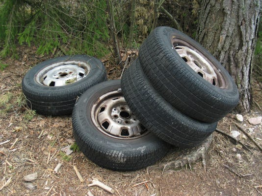 635966865026451932-Tires-in-forest.jpg