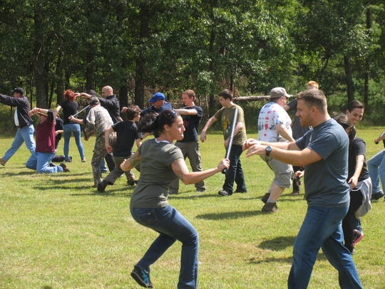 Fight off zombies at Zombie Survival Camp.