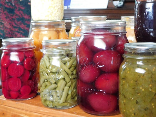 A variety of canned vegetables line the edge of a table at the Fought home.