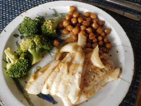 Side of honeyed chickpeas served with sole, broccoli.