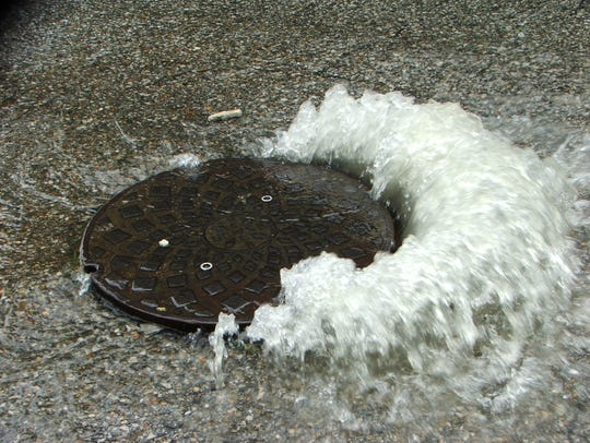 Stormwater caused this sewage overflow from a manhole
