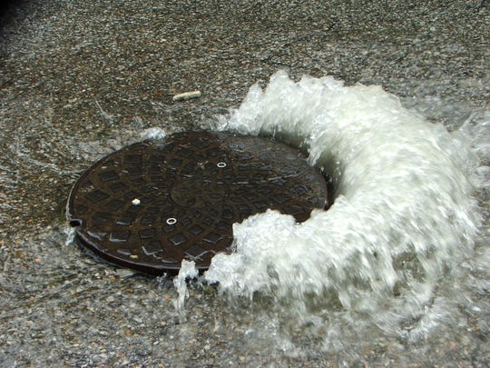 Stormwater caused this sewage overflow from a manhole in the Buechel neighborhood. Date unknown.