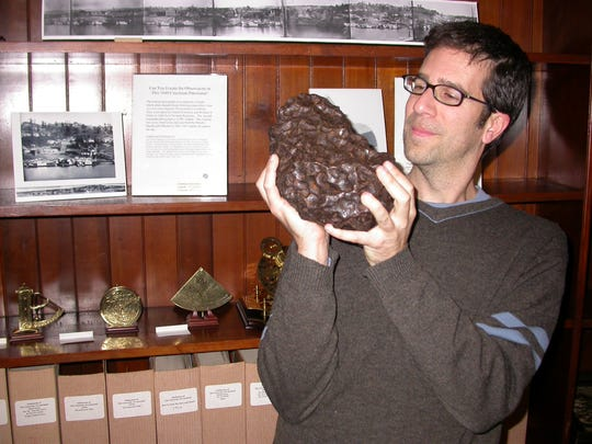 Dean Regas holds a 49-pound meteorite named Campo del Cielo that fell in Argentina 4,000 to 6,000 years ago.