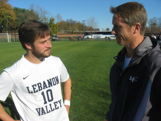 Lebanon Valley College men's soccer coach Charlie Grimes, right, chats with fifth-year senior Cam Alexander.