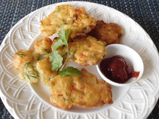 Shrimp fritters served with tomato salsa