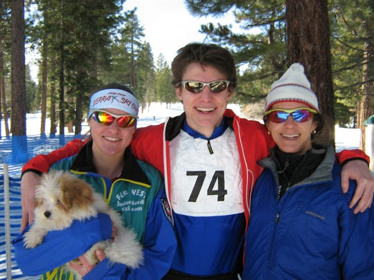 Garrett Reid, center, smiles after winning the overall 20-kilometer Alpenglow cross country ski race at Tahoe Cross Country, while his mother, former Olympian Beth Reid, right, won the woman's division. His sister, Joanne Reid, left, won the 5-kilometer race.