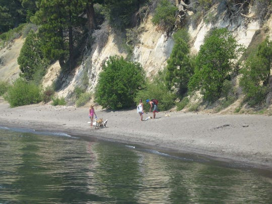 Dogs play along the beach at Skylandia Park and Beach State Recreation Area in northwest Tahoe north of Tahoe City.
