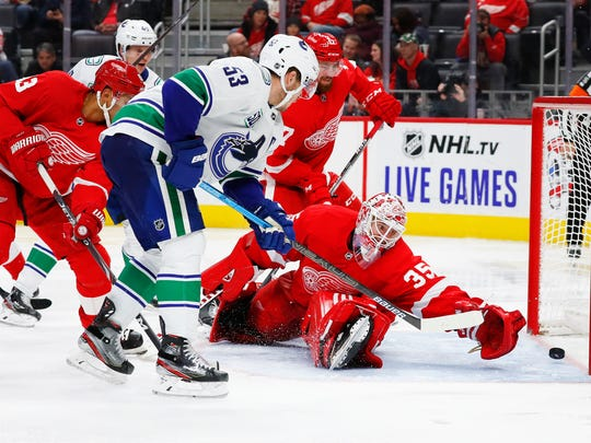 Vancouver Canucks center Bo Horvat (53) scores on Detroit Red Wings goaltender Jimmy Howard (35) during the third period of an NHL hockey game Tuesday, Oct. 22, 2019, in Detroit. (AP Photo/Paul Sancya)