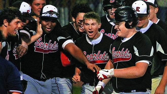 Kyle Thomson, right, is shown after hitting a home run for Des Moines East in 2012. Thomson, 22, and an Iowa State University student, died Monday, Dec. 26, 2016, in a weightlifting accident.