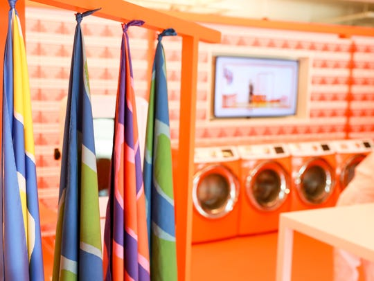 Visitors will be able to give their worn Hermès scarves