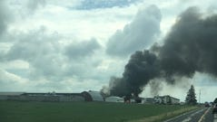 Smoke rises from the scene of a reported plane crash