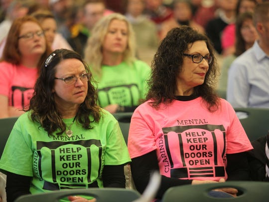 Clarinda Mental Health Institute staff members Teresa Grimes, left, and Janelle Pratt were among more than 200 people who attended a town hall meeting Saturday about the planned closure of the facility.