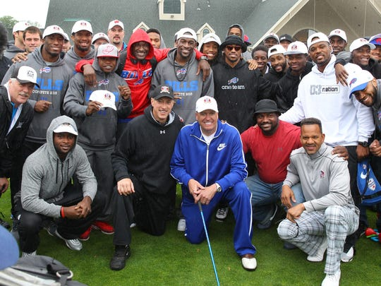 Former Bills great Jim Kelly (center with dark cap), poses with Bills head coach Rex Ryan and current Bills players, as well as former Bills Hall of Fame receiver Andre Reed (front right) at his annual charity golf tournament at Terry Hills Golf Course in Batavia.