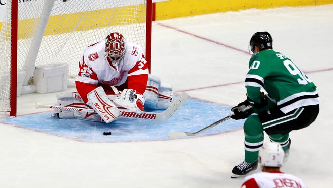 Petr Mrazek blocks a shot against the Stars' Jason Spezza in the third period of the Red Wings' 4-2 loss Tuesday, Oct. 10, 2017, in Dallas.