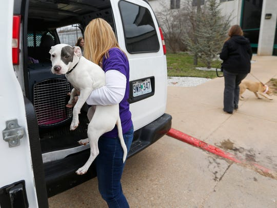 Ellen Dowdy carries Odessa out of the Rescue One van
