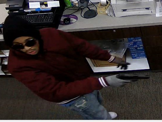 Surveillance video shows one of two suspects sought
