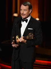 """Bryan Cranston accepts his last Emmy Award for his role in """"Breaking Bad"""" during a break in the production of """"Trumbo."""""""