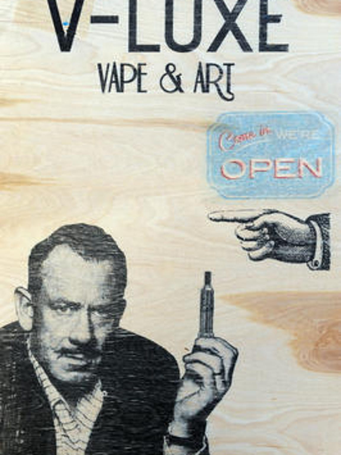 The image of John Steinbeck, who was a smoker, is used to promote a vape and art shop in the Off-Main building in Oldtown Salinas in March 2014. Use of e-cigarettes has boomed among young people in California.