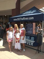 Sharon Dasbach, Lura, Ashley and Caley Hoard won first place in the grandmother/mother/daughter category at the 2011 Mother-Daughter Lookalike Contest at Miromar Outlet Mall.