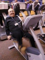 Jim Lokar, of Livonia, cranks away on a recumbent exercise bike in this file photo.