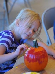 Paint a pumpkin and take it home during the annual Oktoberfest Kids Day in Redford.