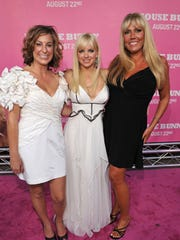 """Karen McCullah (right) stands with writing partner Kirsten Smith and actor Anna Faris during the August 2008 premier of """"The House Bunny."""""""
