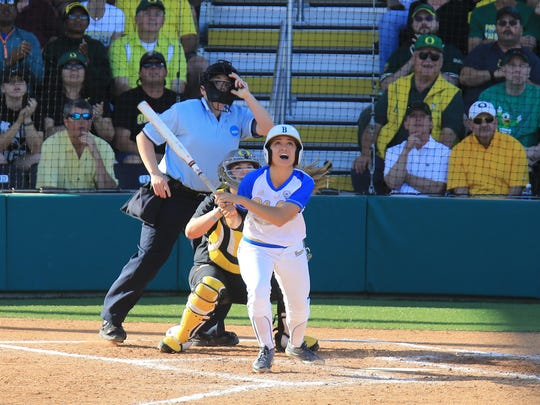 UCLA's Gabrielle Maurice watches as her solo home run in the bottom of the seventh inning to tie the score against Oregon in an NCAA softball tournament super regional game in Eugene, Ore., Sunday, May 29, 2016.