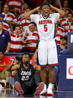 Arizona Wildcats forward Stanley Johnson (5) reacts after being called for a foul against Gonzaga Bulldogs guard Byron Wesley (22) in  the second half of their NCAA basketball game Saturday, Dec. 6, 2014 in Tucson. The Wildcats won 66-63.