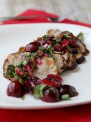 Grilled pork tenderloin with cherry salsa. (Hillary