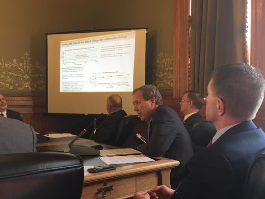 University of Iowa President Bruce Harreld, second from right, gives a budget presentation Wednesday to an Iowa House-Senate appropriations subcommittee in Des Moines. On his right is Board of Regents President Bruce Rastetter.