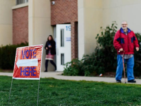 Voters leave Alexander D. Goode School after voting before 7:30 a.m. in York Tuesday, November 8, 2016.