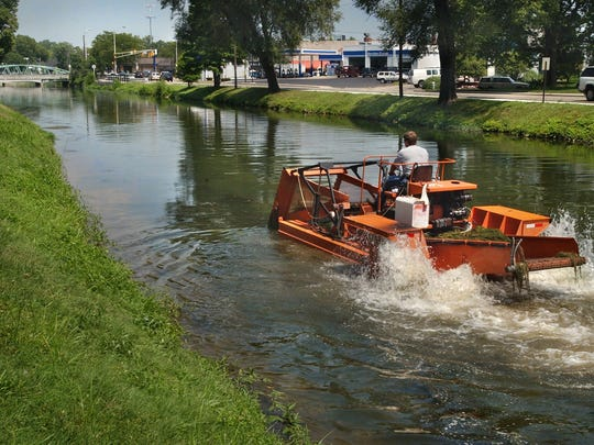 An aquatic weed harvester on the Central Canal in Broad Ripple.