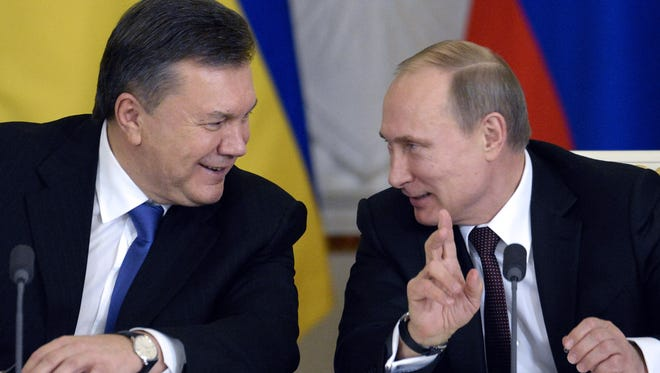 Ukrainian President Viktor Yanukovych, left, and Russian President Vladimir Putin in December in Moscow.