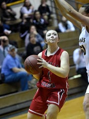 Annville-Cleona's Arianna Clay is blocked at the basket by the Elco defense.
