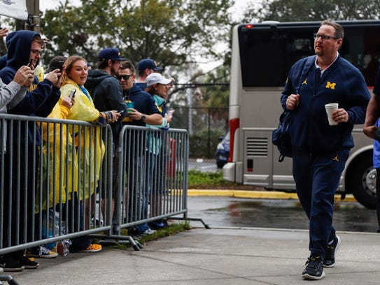 Wolverines offensive coordinator Tim Drevno arrives for the Outback Bowl on  Jan. 1, 2018.