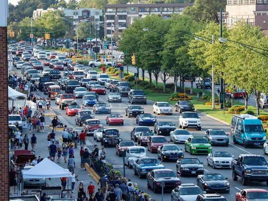 Cars cruising down Woodward Avenue in Birmingham during the Woodward Dream Cruise, Saturday, Aug. 19, 2017.