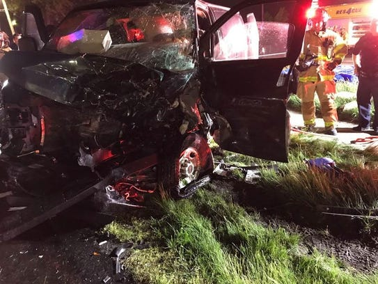 Firefighters at the scene of a crash in Troy on Tuesday