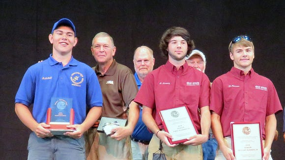 Troy Junior Sportsmen team member Mitchell Robson, left, was the overall individual champion at last week's NRA Youth Hunter Education Challenge national championship.