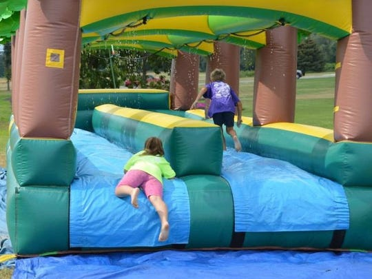 Participants in the fifth annual Julianna and Max's Field Day for Charity take a break to cool off.