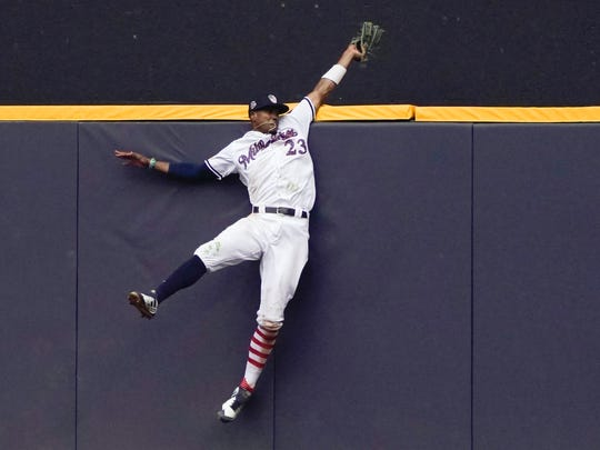 Brewers centerfielder Keon Broxton makes a leaping catch at the wall on a ball hit by the Twins' Brian Dozier during the ninth inning.