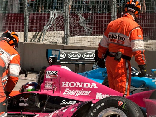 Dario Franchitti suffered two broken vertebrae, a broken right ankle and a concussion in a three-car crash during Sunday's Houston Grand Prix.