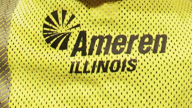 An Ameren Illinois logo is seen on the back of a workers' shirt in a file photo.