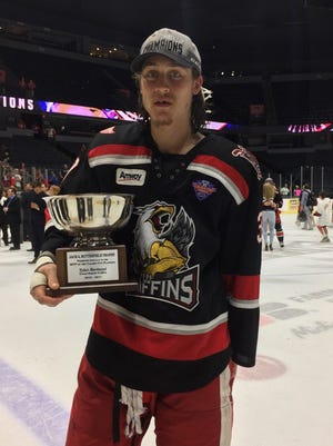 Grand Rapids Griffins forward Tyler Bertuzzi holds his AHL playoff MVP trophy after the 4-3 win over the Syracuse Crunch to win the Calder Cup on Tuesday, June 13, 2017 in Grand Rapids.