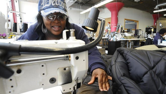 Star Lloyd works on a coat/sleeping bag at the Empowerment Plan startup at Ponyride, a starting point for entrepreneurs in Corktown.