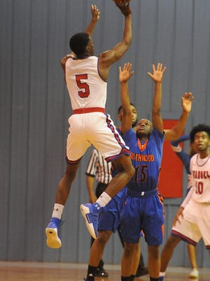 Evangel's Malik Cooper goes up for two points against Southwood Tuesday night at Evangel.